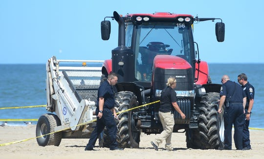 Ocean City Police and Forensics Units look at one of the beach tractors tires near where the body of Ashely O'Connor was found around the 2nd Street beach in Ocean City on Monday, July 31, 2017.  In 2019, the family of O'Connor filed a lawsuit against the Town of Ocean City.