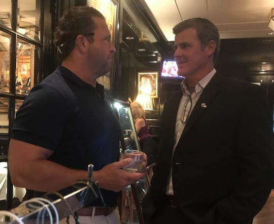 NSU coach Brad Laird visits with former NSU roommate Laine Coleman Thursday at Superior Steak House.