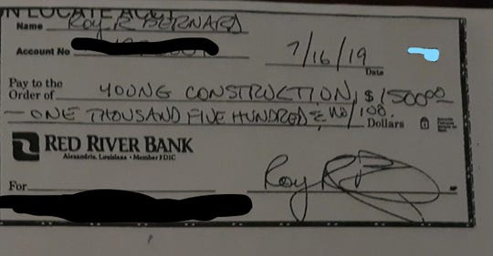 Check from Roy Bernard made out to Young Construction