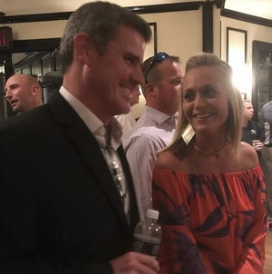 Northwestern State coach Brad Laird shares a laugh with Logansport's Kandi Magee during the NSU Victory Tour stop Thursday at Superior Steak House.