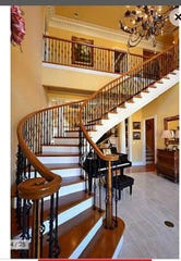 The impeccable landscaping and inviting entrance set the stage for a dazzling, winding staircase in the two-story entryway.