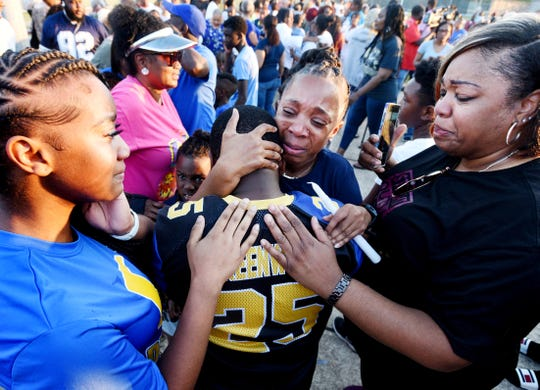 People gather together to shead tears during the community vigil for coach Roderick Gaut Thursday evening July, 25, 2019, at the Bill Cockrell Metro Park.