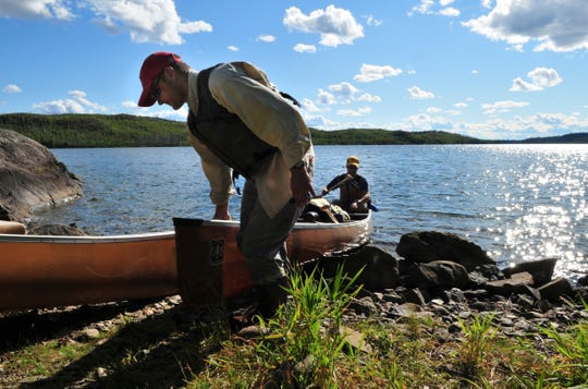 Canoeists land on the shore on Knife Lake in the Boundary Waters Canoe Area Wilderness in this file photo.