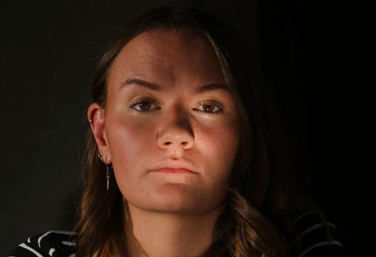 In this Monday, July 22, 2019, photo, Rachel Whalen poses at her home in Draper, Utah. Whalen remembers feeling gutted in high school when a former friend would mock her online postings, threaten to unfollow or unfriend her on social media and post inside jokes about her to others online. The cyberbullying was so distressing that Whalen even contemplated suicide. There's a rise in cyberbullying nationwide, with three times as many girls reporting being harassed online or by text message than boys, according to the National Center for Education Statistics. (AP Photo/Rick Bowmer)