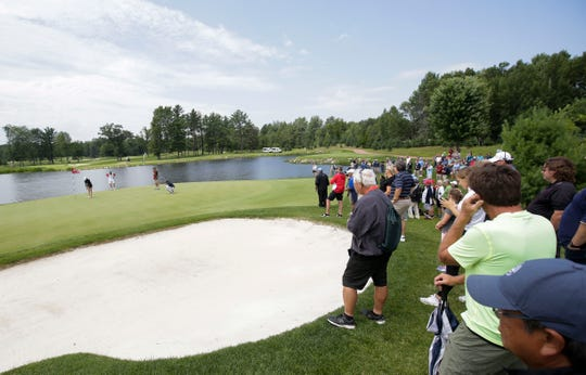 Spectators gather to watch as Jillian Bourdage prepares to putt during the semifinal round of the USGA Girls' Junior Championships on  July 26 at SentryWorld in Stevens Point.