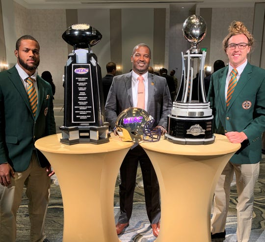 FAMU football head coach Willie Simmons poses with linebacker Elijah Richardson (left) and quarterback Ryan Stanley during MEAC Media Day in Norfolk, Virginia on Friday, July 26, 2019.