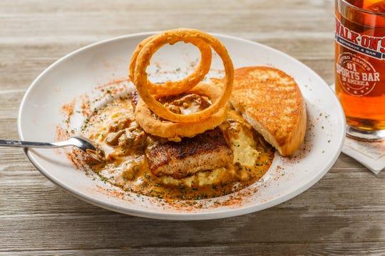 Mardi Gras Mahi is blackened mahi mahi, crawfish mushroom sauce, corn grits, onion strings and a side of garlic bread.