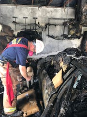 Firefighters said the fire started in the garage. The cause of the fire was being investigated Friday morning.