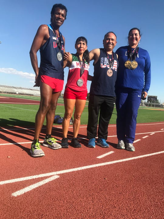 From left, David Jackson, Virginia Garcia Jackson, Jorge Cobos and Elizabeth Teague display the medals they won at the North and Central America and Caribbean Region of World Masters Athletics July 18-21 in Toronto