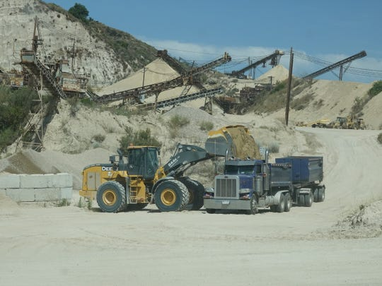 A truck gets loaded up at the Cemex sand and gravel quarry on Grimes Canyon Road outside Moorpark.