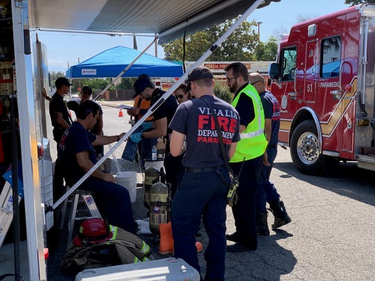 Tulare Kings Hazmat team investigates buckets of an 'unknown substance' in Visalia on Friday, July 26, 2019.