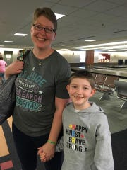 Kirsten, left, and Claire Hornby arrive in Wisconsin in early July, at the start of a break from Claire's treatment for a brain tumor at St. Jude's Children's Research Hospital.