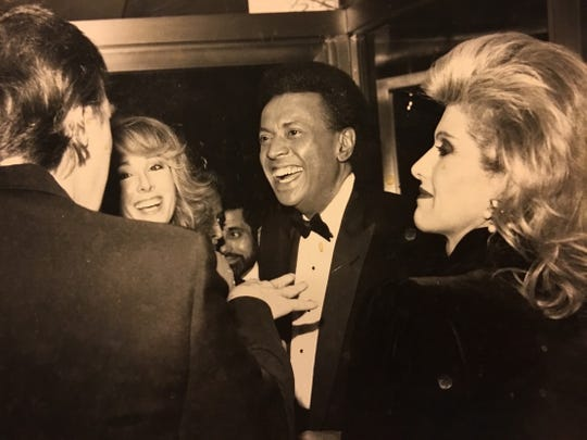Donald Trump (left) and E. Jean Carroll (second from left, with then-husband John Johnson) in a photograph Carroll says dates from a 1987 party they attended.