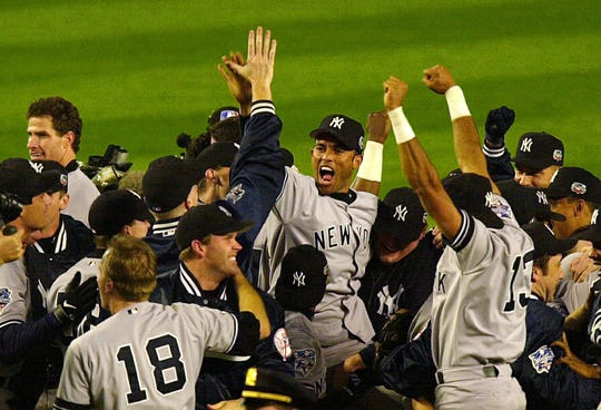 Yankees Mariano Rivera and his teammates celebrate the 2000 World Series victory over the Mets.