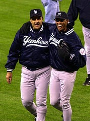 Yankee manager Joe Torre and pitcher Mariano Rivera during game 5 of the ALCS at Safeco Field in Seattle, ( Frank Becerra, Jr. /The Journal News 10/15/2000 )