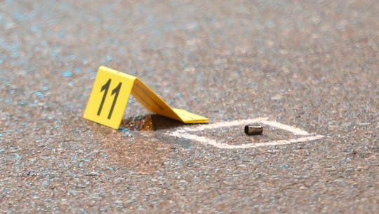 An evidence marker notes a spent bullet casing where police said a 66-year-old man was shot on the 700 block of West Fourth Street about 10:13 p.m. Thursday.