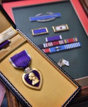 The Purple Heart and other military awards of Cpl. Truman Davis who was wounded and captured as a POW in the Korean War. Davis died Tuesday July 23rd at age 90.