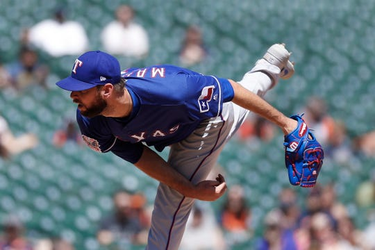 Texas Rangers relief pitcher Chris Martin throws in the eighth inning of a baseball game against the Detroit Tigers in Detroit, Thursday, June 27, 2019. (AP Photo/Paul Sancya)