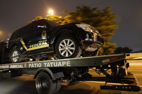 A fake police truck that was used in robbery is transported on a flat-bed truck in Sao Paulo, Brazil, Thursday, July 25, 2019.