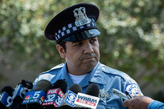 Chicago police officer Jose Jara talks to the media outside a police station in Chicago on Wednesday, July 24, 2019. He briefed the media about an investigation into a video showing several young girls or women beating a 15-year-old girl as onlookers laugh.