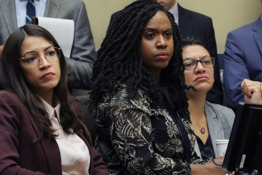Rep. Alexandria Ocasio-Cortez, Ayanna Pressley and Rashida Tlaib attend a hearing on drug pricing in the Rayburn House Office building on Capitol Hill July 26, 2019 in Washington, DC.