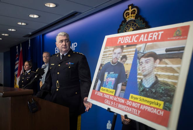 Security camera images recorded in Saskatchewan of Kam McLeod, 19, and Bryer Schmegelsky, 18, are displayed as Royal Canadian Mounted Police Assistant Commissioner Kevin Hackett steps away from the podium after speaking during a news conference in Surrey, British Columbia, on  July 23, 2019. RCMP say two British Columbia teenagers who were first thought to be missing are now considered suspects in the deaths of three people in northern British Columbia.