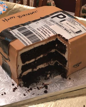 This courtesy photo from Emily McGuire shows the birthday cake her husband ordered for her from Sweet Dreams Bakery in Dunn, North Carolina. The whole cake, decorated like an Amazon package, was edible.