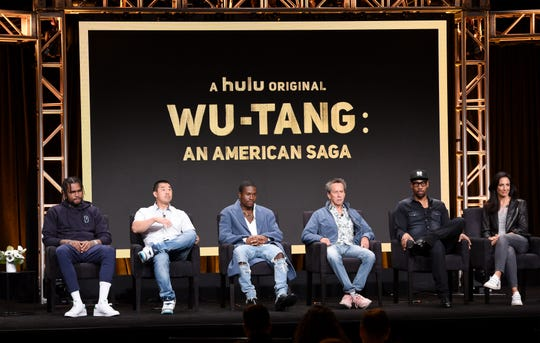 """From left, Dave East, Alex Tse, Shameik Moore, Brian Grazer, RZA, and Francie Calfo speak onstage about """"Wu Tang: An American Saga"""" during the Hulu 2019 Summer TCA Press Tour"""