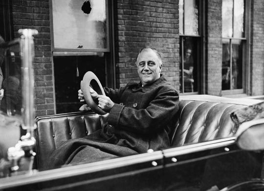 Then governor of New York Franklin D. Roosevelt poses in his car in Albany on  Oct. 29, 1932.