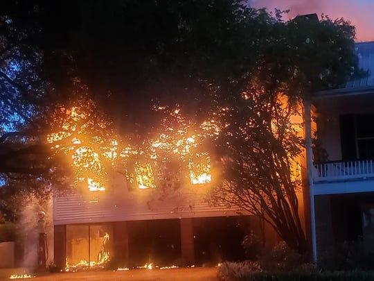 Frogmore Plantation main house was engulfed in flames Friday night.