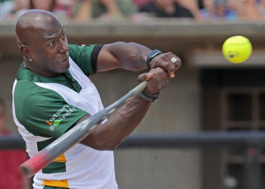 Donald Driver bats during his charity softball game Saturday at Neuroscience Group Field at Fox Cities Stadium in Grand Chute.