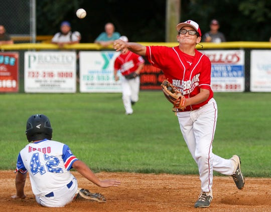 Holbrook shortstop Nicholas LoVacco tries to turn a double play against Elmora in the 2019 NJ State Little League Tournament in Sayreville on July 26, 2019. (Photo by Keith Muccilli, Correspondent)
