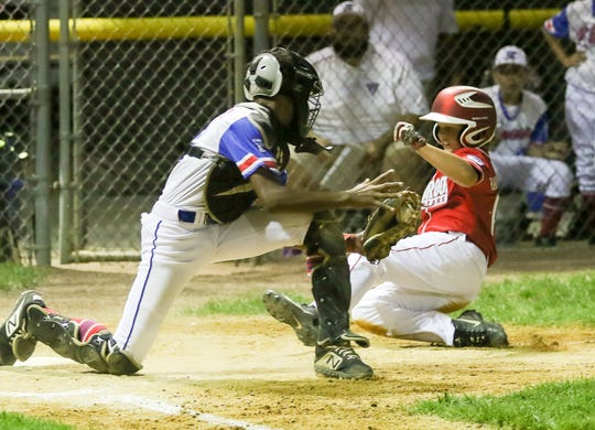 Holbrook's Max Rakestraw, right, scores, avoiding the tag by Elmora catcher Joel Sanchez in the 2019 NJ State Little League Tournament between Elmora and Holbrook in Sayreville on July 26, 2019. (Photo by Keith Muccilli, Correspondent)