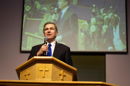 In this July 14 photo, Democratic Gov. Roy Cooper speaks at Mount Olive Missionary Baptist Church in Fayetteville about his desire to expand Medicaid health coverage to several hundred thousand lower-income North Carolinians. Cooper's leverage is now being tested in a budget stalemate, as he pressures Republican legislators to expand Medicaid. He vetoed the state budget last month in part because it failed to expand Medicaid to hundreds of thousands of people.
