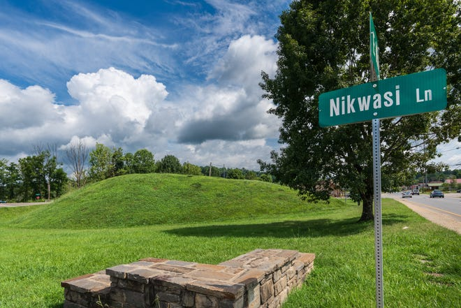 An estimated 1,000 years old, 15-foot tall Nikwasi Mound is all that remains of a once major, 100-acre Indian village displaced by modern-day Franklin. Historians say the mound served as both villagers' meeting place and sacred site.