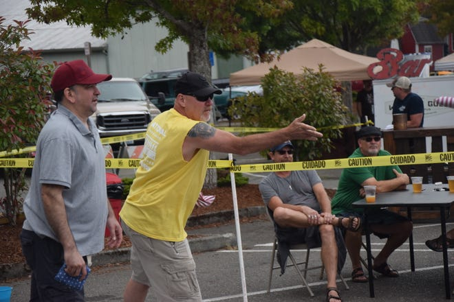 """Briant Jenkins of team """"Briant and Mike"""" makes a toss at the Kitsap Cornhole Classic."""