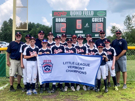 The Connecticut Valley North team poses with the banner after wining the 11-12-year-old Little League baseball state championship on Saturday in Barre.