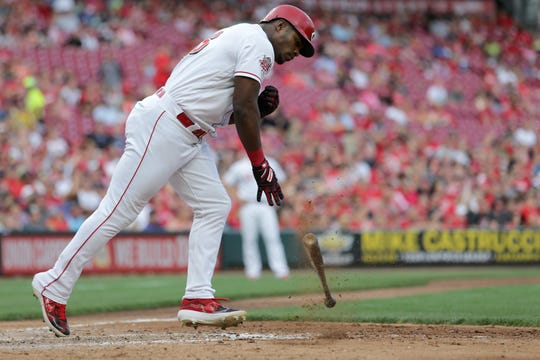 Cincinnati Reds right fielder Yasiel Puig (66) throws his bat down in the fourth inning of an MLB baseball game against the Colorado Rockies, Friday, July 26, 2019, at Great American Ball Park in Cincinnati.