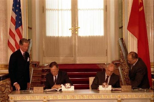 On 31 July 1991, the US President, George Bush (sitting on the left), and General Secretary of the Communist Party of the Soviet Union, Mikhail Gorbachev (sitting on the right), sign the START I Agreement for the mutual elimination of the two countries' strategic nuclear weapons.
