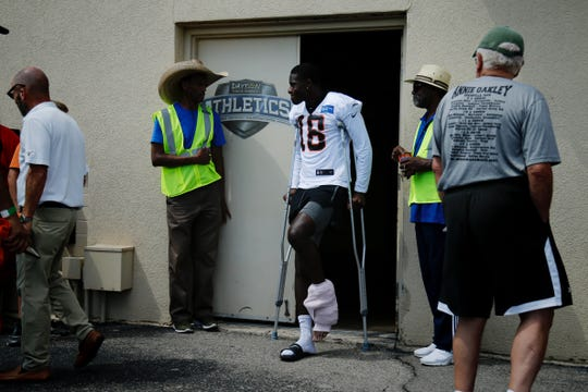 Bengals wide receiver A.J. Green was on crutches with his left ankle and lower leg wrapped at the team's first day of training camp at Welcome Stadium in Dayton, Ohio, July 27, 2019.
