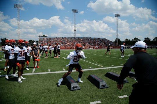 Cincinnati Bengals running back Giovani Bernard (25) runs through a ball security drill during the opening day of training camp at Welcome Stadium in Dayton, Ohio, on Saturday, July 27, 2019.