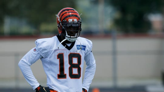 Cincinnati Bengals wide receiver A.J. Green (18) rests between reps during the opening day of training camp at Welcome Stadium in Dayton, Ohio, on Saturday, July 27, 2019.