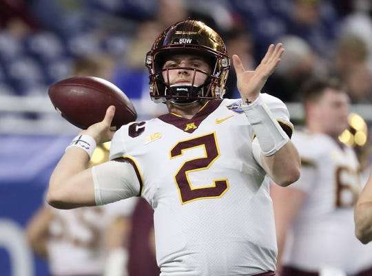 Minnesota Golden Gophers quarterback Tanner Morgan (2) warms up prior to the start of the 2018 Quick Lane Bowl against the Georgia Tech Yellow Jackets at Ford Field.