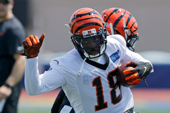 Cincinnati Bengals wide receiver A.J. Green (18) runs with a catch during the opening day of training camp at Welcome Stadium in Dayton, Ohio, on Saturday, July 27, 2019.