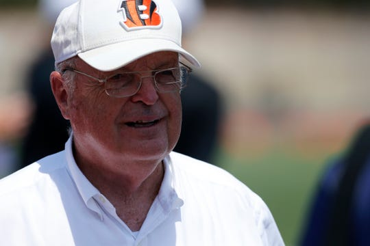 Bengals owner Mike Brown walks the field during the opening day of training camp at Welcome Stadium in Dayton, Ohio, on Saturday, July 27, 2019.