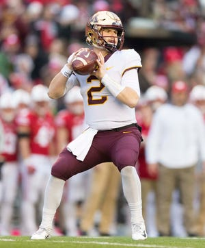 Minnesota Golden Gophers quarterback Tanner Morgan (2) throws a pass during the first quarter against the Wisconsin Badgers at Camp Randall Stadium.