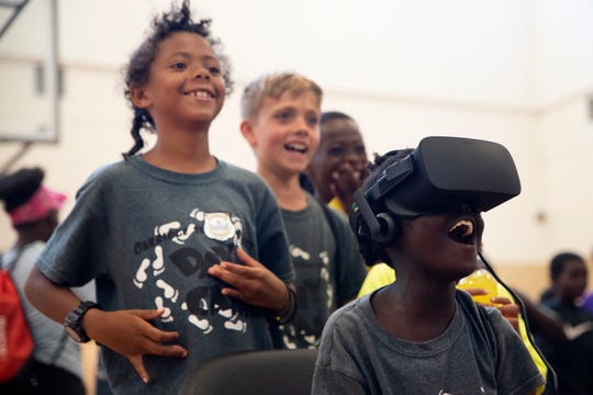 Aachan Wol, 9, right, rides a virtual-reality roller coaster as part of Des Moines' STEM on the Ridge program at Oakridge Neighborhood on July 26, 2019.