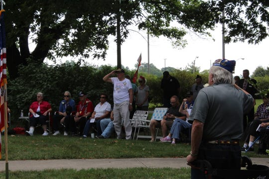 """Veterans of the Korean War stand as """"Amazing Grace"""" is played on a set of bagpipes at a commemoration of the signing of the Armistice to end the Korean War on Saturday, July 27, 2019, near the State Capitol Building in Des Moines."""