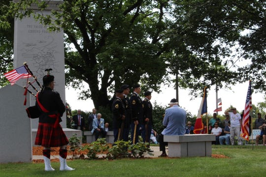"""Ron Husted plays """"Amazing Grace"""" on the bagpipes for a silent audience during a commemoration of the signing of the armistice to end the Korean War on Saturday, July 27, 2019, near the State Capitol Building in Des Moines."""