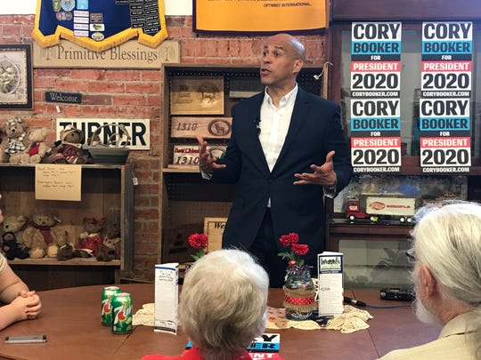 U.S. Sen. Cory Booker of New Jersey speaks to voters at a Greenfield coffee shop on Friday, July 26, 2019